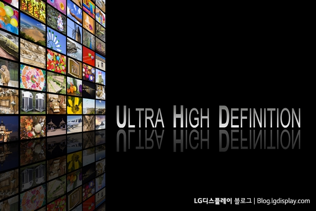 Concept of Ultra High Definition TV on black background with reflection